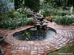 making an inexpensive garden pond, outdoor living, perennial, ponds water features, Finished garden pond The pond is kinda kidney shaped and it surrounded by old brick we got from a school that was being torn down Back Gardens, Outdoor Gardens, Water Gardens, Ponds Backyard, Garden Ponds, Backyard Waterfalls, Koi Ponds, Goldfish Pond, Pond Fountains