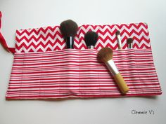 Brush Roll in Red and White Chevron Design with Coordinating Directional Stripes.