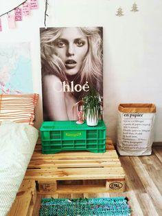 My bedroom- plastic crate, paper bag, anja rubik poster chloe parfume, palettes, eclectic mix.