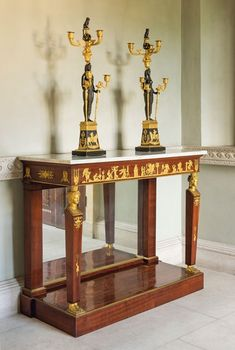 A pair of Russian ormolu and patinated-bronze five-light candelabra, early 19th century. 33 in (84 cm) high; 10½ in (26.5 cm) wide; 9¼ in (23.5 cm) deep. An Empire ormolu-mounted mahogany console table, attributed to Georges Jacob and François-Honoré Jacob-Desmalter, circa 1805. 38 in (96.5 cm) high; 46⅛ in (117 cm) wide; 19¾ in (50 cm) deep.