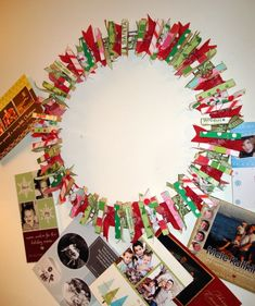 clothespin wreath to hang christmas cards love this! This would be cute in other colors in a bedroom instead of cork board.