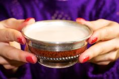 Mongolian milk tea served in a traditional silver lined bowl.