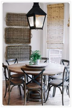 Baskets on wall, lantern, round table