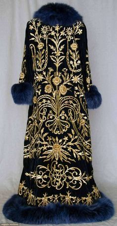 Ottoman Embroidered Caftan Made Of Sapphire Blue Velvet With Heavy Gold 3-Dimensional Floral And Vine Embroidered Front And Back, V-Neck Blue Dyed Fox Fur Collar And Hem Trim    c.19th Century