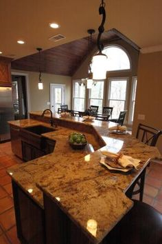 Kitchen Islands With Seating | large island with seating, prep area, and sink by evangeline