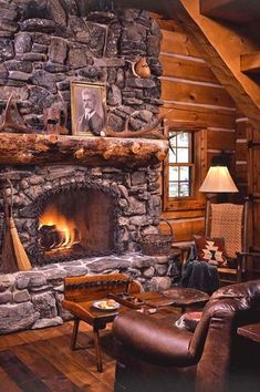 Rustic Living Room with double-hung window, Hardwood floors, Accent pillows, Exposed beam, Wood coffee table, stone fireplace