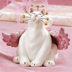 """""""Angelica"""" Whimsiclay Cat Figurine by artist: Amy Lacombe. It features angel wings, a gold colored halo and gold colored whisker tips."""