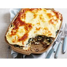 This vegetarian mushroom and spinach lasagne recipe is complete with a homemade bechamel sauce, creamy ricotta & Parmesan for a tasty meat free meal.
