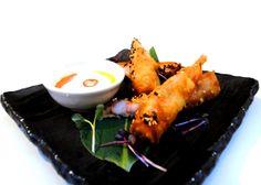 King Prawn Spring Rolls - juicy prawns & coriander in crunchy rolls with sesame, served with spicy Jalapeño Mayo