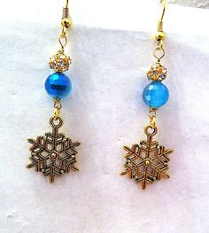 Golden snowflake earrings with two toned blue by BeadingByJenn #jewelry #earrings #Christmas #christmasjewelry #winterjewelry #winterfashion #snowflakes #snowflakeearrings #blue #frozen #handmadejewelry #beadingbyjenn #etsy #womens #accessories