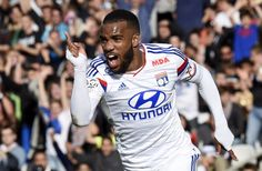 Lyon's French forward Alexandre Lacazette celebrates after scoring a goal during the French Ligue 1 football match between Olympique Lyonnais (OL) and SC Bastia, at the Gerland stadium, central-eastern France, on April 27, 2014.