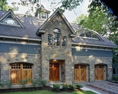 the stone w/the wood carriage house garage doors looks great