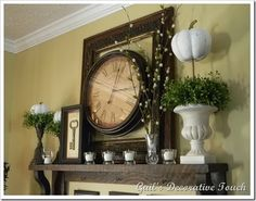 LOVE the Mantel decor with clock and picture frame