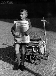 World War II - waste paper 1943 - 42-35304639 - Rights Managed - Stock Photo - Corbis. A boy has collected old newspapers and brings them to the collecting point at his school, in March 1943. Germany