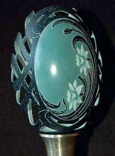 Eggshell Carvings - This is an emu egg, and the colors you see are the natural egg shell color carved in the back, and carving to expose different colored layers in the shell, on the front.