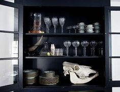 the selby book: black inside cabinet shelving!