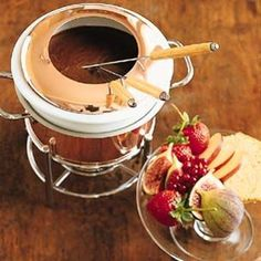 Cupcake Fondue Dip bits of cake in warm frosting of choice them dip into cake confetti, coconut, chocholate ect whatever please the taste`s