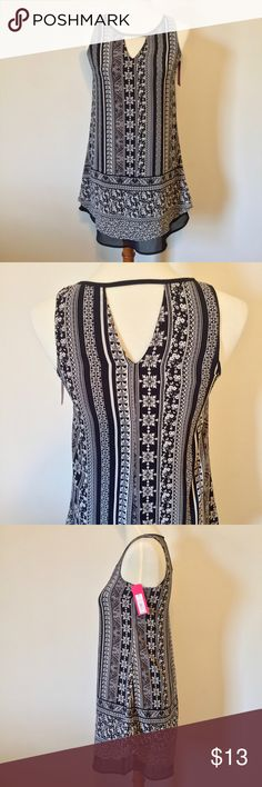 """NWT Kehole Black & White Sleevless Shift Dress NEW with tags! I love the black and white print on this cute little dress. Size XS. Measures 16"""" across bust and 32"""" in length. Smoke-free home. Fast shipping. Thank you for looking! Xhilaration Dresses Midi"""