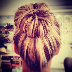 Make a high bun, pull out sections of hair & braid them, then pin them back up with bobby pins. LOVE!