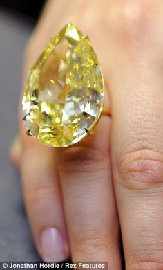 The Cora Sun-Drop is among the most stunning diamonds in the world, so rare that it is almost impossibe to determine its value. At 110-carats, the Cora Sun-Drop is roughly the size of a woman's thumb and is the largest vivid yellow pear-shaped diamond known in the world.