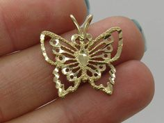 SALE... Solid 14 K Gold Diamond Cut Pendant Butterfly