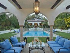 devine pools ~ love the furniture.
