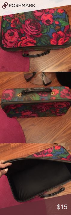 Floral vintage suit case Love this but never use it! It is in great condition. Zipper works and handle is leather. The dims are 5 inches deep. 11 1/2 inches high and 18 1/2 wide. Bags Travel Bags