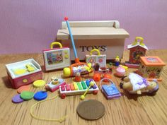 Set of 12 handmade replica miniature vintage fisher price toys for a girl + toy box, 1/12 scale for a dolls house