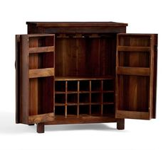 This exceptionally well-made cabinet draws on the design of a rustic sideboard found in a country home. It's built to accommodate smaller spaces yet offers ample storage, including wine cubbies and stemware holders. Home Bar Decor, Wood Media Console, Rustic Sideboard, Bar Cart Decor, Home Bar Furniture, Contemporary House Design, Bar Cabinet, Reclaimed Wood Media Console, Reclaimed Wood Bars