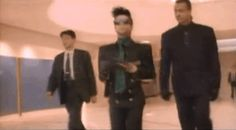 (Half-brother Duane Nelson, his sometime bodyguard walks behind him. Flapper Style, 1920s Flapper, Prince Gifs, Z Music, Pictures Of Prince, American Bandstand, I Love You Forever, Roger Nelson, Prince Rogers Nelson
