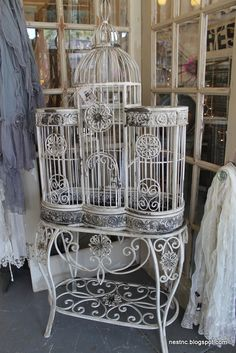 i don't like birds to be kept in cages, but this cage design is just stunning.