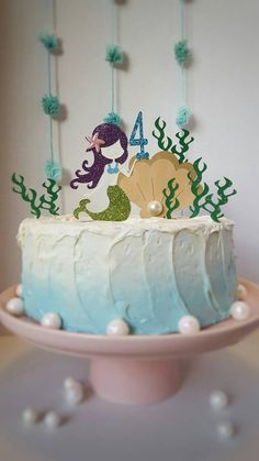 Cake topper measure approx. 5 inches wide and 4.5 inches tall (not including pick). Fits most round homemade cake perfect!Mermaid cake topper w/ age or initial. 3 piece one sided glittered, Little Mermaid! Under the sea! Girls Party! Mermaid Theme Party!