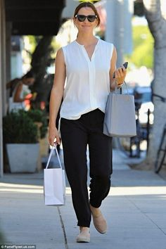 Monochrome magic: Looking elegant in a monochrome ensemble, the actress, kept things sartorially simple in a sleeveless white shirt and loose fitting black trousers Jennifer Garner Elektra, Jennifer Garner Style, Stylish Work Outfits, Modern Outfits, Stylish Outfits, Dressy Outfits, Business Outfits Women, Business Clothes, Celine