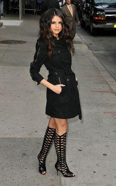 #SelenaGomez black trench coat and knee high gladiator heels