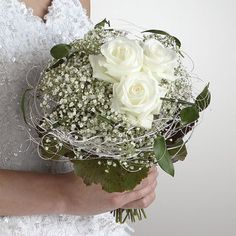 Baby's breath and rose bouquet with green foliage