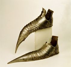 Sabatons are armoured footwear worn as part of a complete suit of amour. This pair of authentic German gothic sabatons are from 1490.