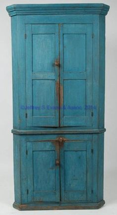 "Price Realized: 3,335.00 BEDFORD CO., PENNSYLVANIA PAINTED POPLAR CORNER CUPBOARD, one-piece construction, a fine diminutive example with well-executed molded cornice above double-paneled upper doors, applied waist moldings, and fielded-panel lower doors, resting on a base with applied moldings. Blue-painted surface. Circa 1830-1850. 75"" H, 35"" W, 24"" corner.   Provenance: Collection of the late John and Lil Palmer, Purcellville, VA.  Ex-collection of Skip and Effie Sheppard, PA, 1994."