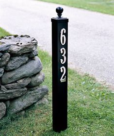 House numbers are mounted on a wooden deck or fence post. NEED to do - our house #'s are hard to see, especially at night :/