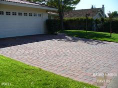 This client actually inspired their next door neighbor to get pavers as well. Simple t-pattern driveway. They also added a walkway to add continuity to the front. See it here - http://www.bairdandsons.com/project-showcase-paver-patterns/paver-walkways/#jp-carousel-698