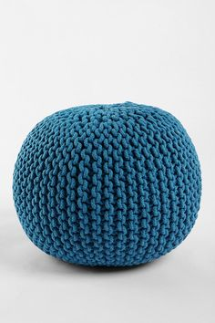 I like this but what good is a pouf?! Maybe if it didn't look like a medicine ball you could sit on it.