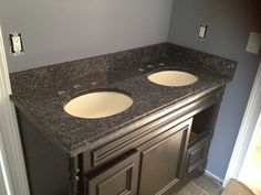 Blue pearl granite vanity top. Not sure I like dark cabinets with Blue Pearl.