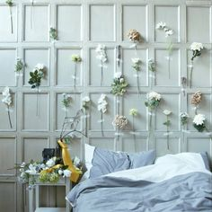 Creative wall ideas - Create your own wallpaper with SMYCKA artificial flowers. Very unique idea but I somehow LOVE IT!