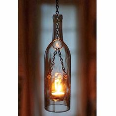 Check out this awesome wine bottle light fixture! #hickoryandbirch #loveyourhome #interior_design #home #love #interiorstyling #rustic #rusticlifestyle #house #design #winebottle #winebottles #wine #bottle #bottles #repurposed #reuse #lights #inspired #rural #rurallife #ruralamerica #industrial #industrialdecor #lightfixture #light #fixture #inspiration by hickoryandbirch