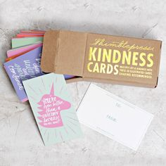 Think of this foil stamped box as a box of cheer! The 50 business-sized cards within hold uplifting, giggle-worthy and contented messages. These words will brighten your decor, wallet, car's dashboard