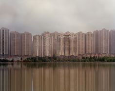 Vast cities in China& new industrial zones sit waiting for a workforce yet to arrive. Photographers like Raphael Olivier and Kai Caemmerer have documented them in haunting images. Ghost City, Ghost Towns, Kai, Abandoned Buildings, Abandoned Places, In China, High Rise Apartments, Modern City, Futuristic Architecture