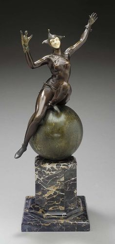 A PATINATED BRONZE, PARCEL-GILT AND IVORY SCULPTURE - CAST AND CARVED FROM A MODEL BY MAURICE GUIRAUD-RIVIERE, CIRCA 1930.