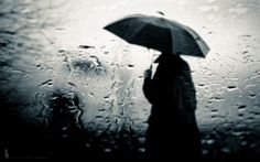 A man standing outside in the rain with an umbrella Rainy Mood, Rainy Night, Rainy Days, Wallpaper Glass, Boys Wallpaper, Black Wallpaper, Moving On Quotes, Rainy Day Wallpaper, Image Triste