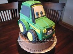 Homemade 3D John Deere Tractor Cake: My idea for a Homemade 3D John Deere Tractor Cake started out with thinking that I would use a tractor loaf pan and then add a three dimension to the wheel