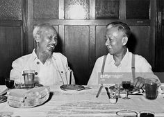 President of People's Republic of China Liu Shaoqi (R) shares a laugh with his North vietnamese counterpart Ho Chi Minh (L), in August 1959 during a lunch in Beijing.
