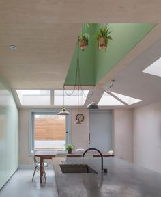 Transformation of a tired Victorian house in North London using pigmented cast concrete for new spaces.